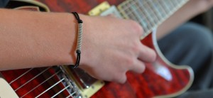 Adjustable_Leather_Guitar_String_Bracelet_by_High_Strung_Studios